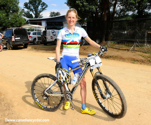 Catharine Pendrel shows off her matching rainbow kit